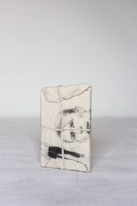 Nicolas de Stael, 2003, Mixed media on fabric, book, thread and elastic band, 23 x 15 x 2,5 cm.